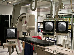 Philips Integris model cath lab room view with Modalixx G202MG LCD upgrades on pre-existing ceiling suspended tray.